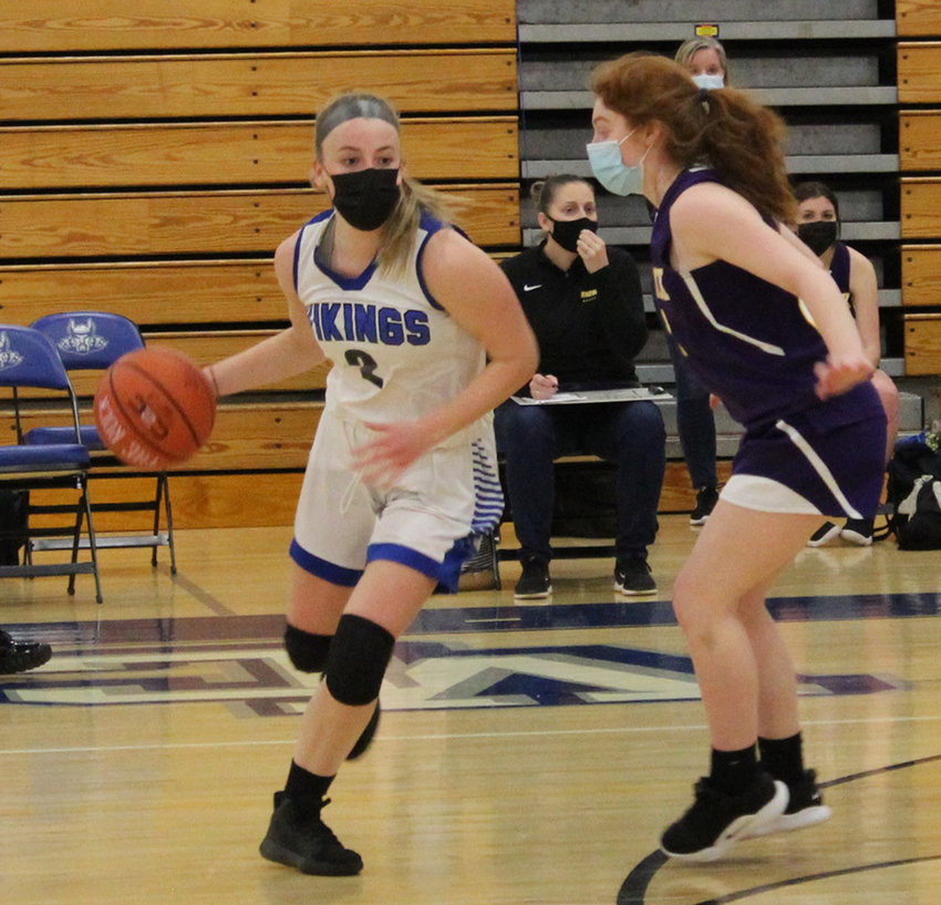 Valley Central's Madeline Feller dribbles around Warwick's Mia Ponzo during Friday's girls' basketball game at Valley Central High School in Montgomery.