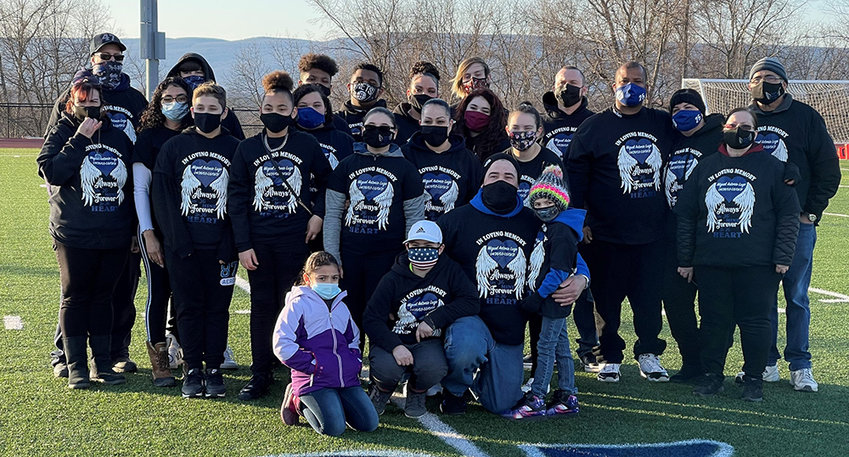 The family of Miguel Lugo, who died after practice on March 1 after the first day of football practice, at the 25-yard line of the Wallkill High School football fields, where Lugo's number was painted into the turf. The Town of Plattekill wants to plant a tree in his memory at the town park.