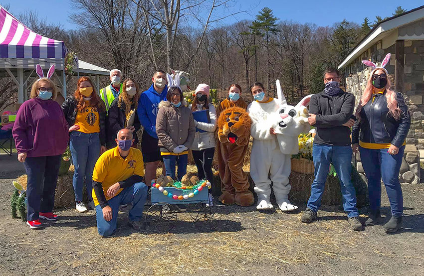 Members of the Wallkill Lions Club and the Wallkill Senior High School Leo's Club gather for a group photo on the day of the drive-thru Easter event.
