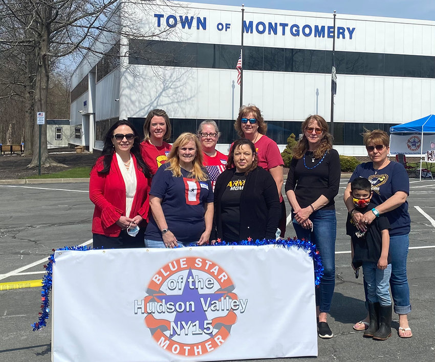The Hudson Valley chapter of the Blue Star Mothers of America pose at their donation drive on Friday in front of Montgomery Town Hall.