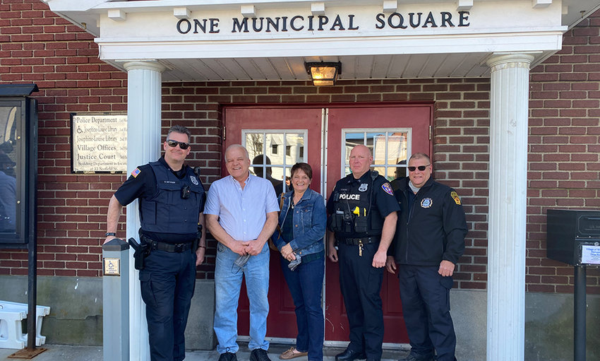 Members of the Walden Police and Fire Departments who helped save Trudy Amrhein from drowning in 2001 pose with her parents at village hall. Last Monday was the 20th anniversary of the incident. From left to right: Officer Eric Metzger, Brian Amrhein, Robin Amrhein, Officer David Kurtz and Firefighter Jason Faso.