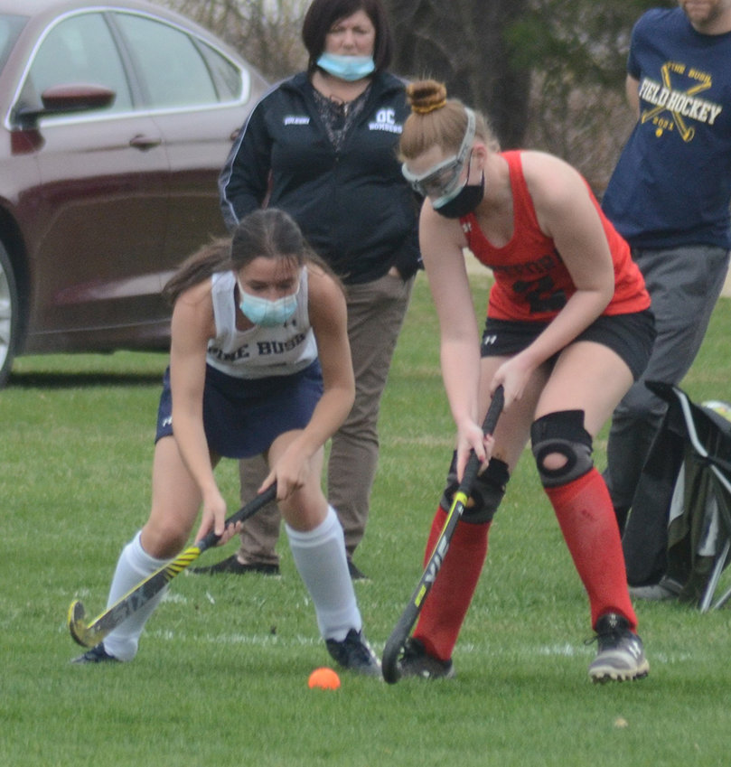 Pine Bush's Alexa Reeves battles Onteora's Jessica Zygmunt for the ball during Friday's MHAL field hockey game at Pine Bush Elementary School.