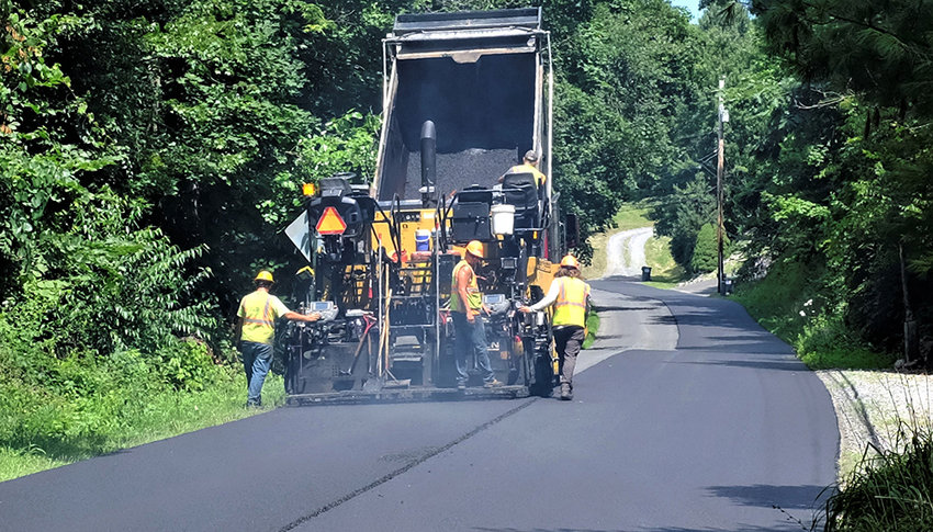 Next month paving and repair work will begin on roads in the Town of Lloyd. Pictured is a crew paving S. Chodikee Lake Road last July.