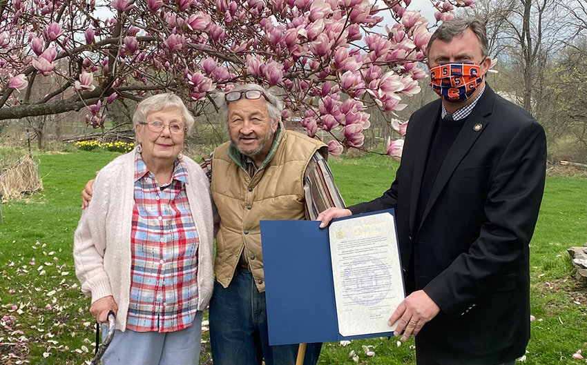 Brian Miller (right), assemblyman for the 101st New York State Assembly District, presents Robert Ewald with a citation for earning the New York State Outdoorsmen Hall of Fame Association's Educational Program Award. Also pictured is Helen Ewald.