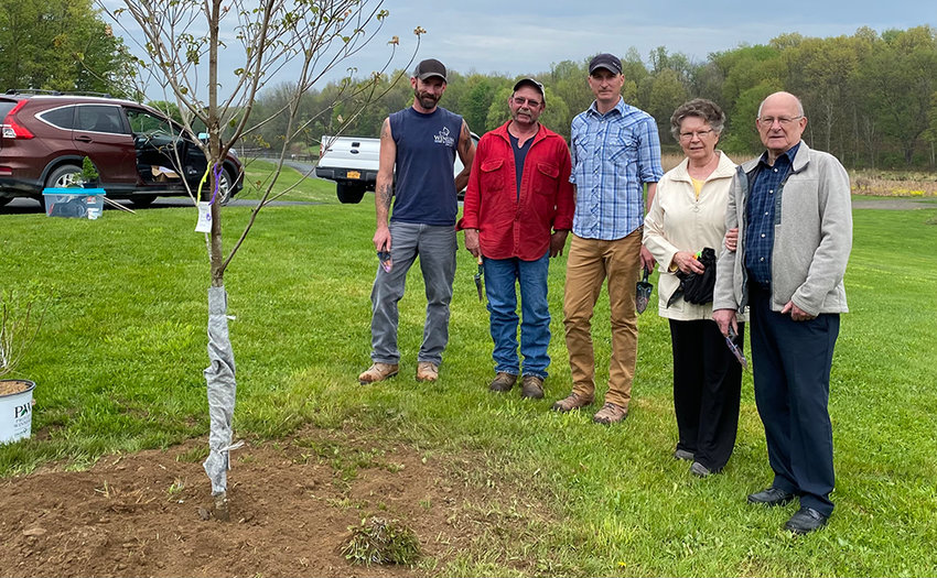 The Winum family pose next to the tree dedicated to their family member Police Officer Dominic Winum, who was killed serving in the line of duty. From left to right: Karl Winum, Nat Winum, Brant Winum, Dominic's mother Jean Winum and Dominic's father Larry Winum.