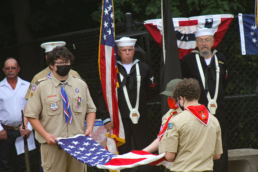 Boy Scouts from Troops 31 and 33 demonstrate flag folding techniques during Walden's Flag Day ceremony at Veteran's Memorial Park.