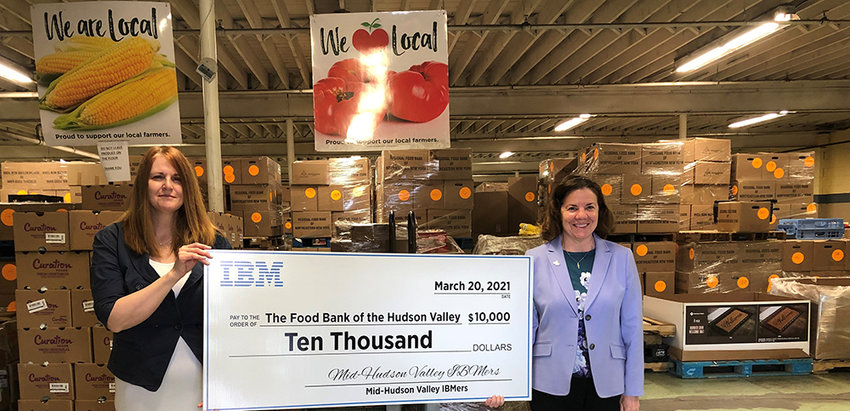 IBM Senior Location Executive Maria Boonie (right) presents a $10,000 check from IBM to the director of the Food Bank of the Hudson Valley, Sara Gunn.