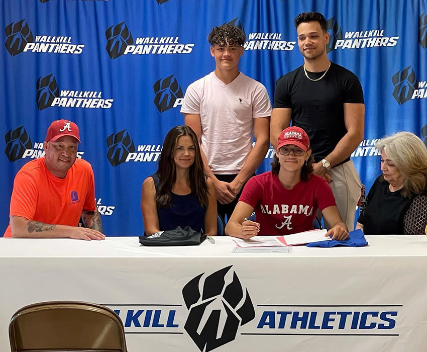 Wallkill senior Louis Martinez is shown with his family after signing his National Letter of Intent to pole vault at the University of Alabama on June 22 at Wallkill High School.