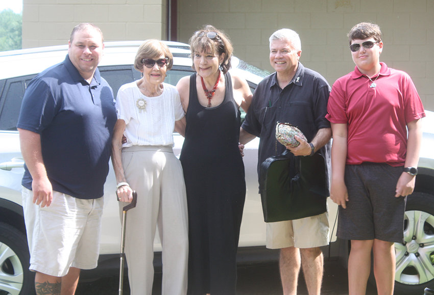 """Anita Vandermark is welcomed to Walden's Olley Park by (l.-r.) Recreation Director Mike Bliss, Anita, daughter Sandy Magill, Walden Mayor John Ramos and Andrew Ramos. The village officials surprised her by announcing that the proposed new Community Center at Olley Park would be named """"The Anita Louise Vandermark Community Center."""""""
