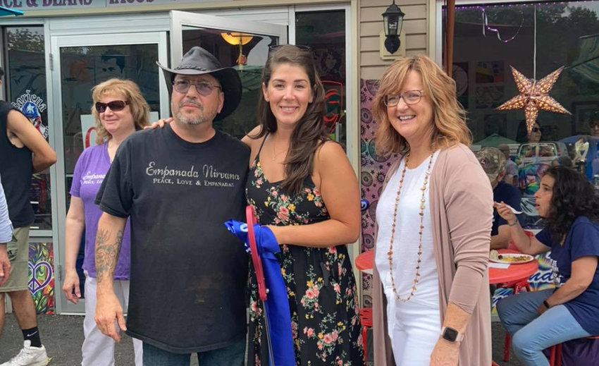 Empanada Nirvana owner Nelson Pantoja (left) poses for a photograph with Business Council of Greater Montgomery Executive Director Randi Picarello (center) and Town of Crawford Councilwoman Kelly Eskew (right) at the restaurant's ribbon-cutting ceremony on Saturday.