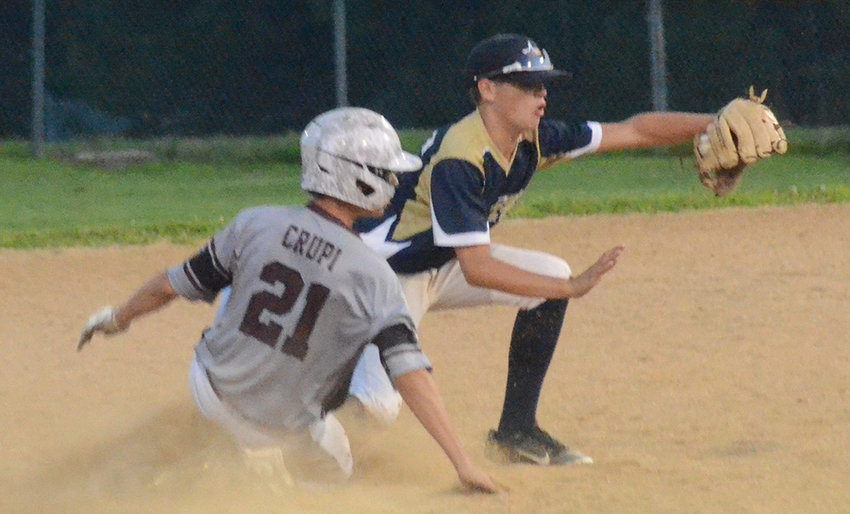 Pine Bush second baseman Justin Engelsen tries to double off Harrison's Joe Crupi during Wednesday's Section 3 North Junior baseball championship game at Stony Point Little League.