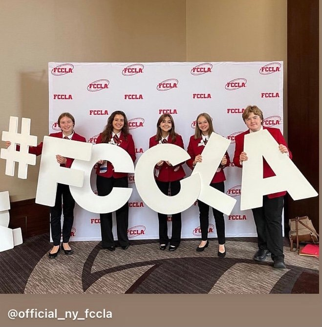 Marlboro High School members and NYS officers pose with #FCCLA sign.