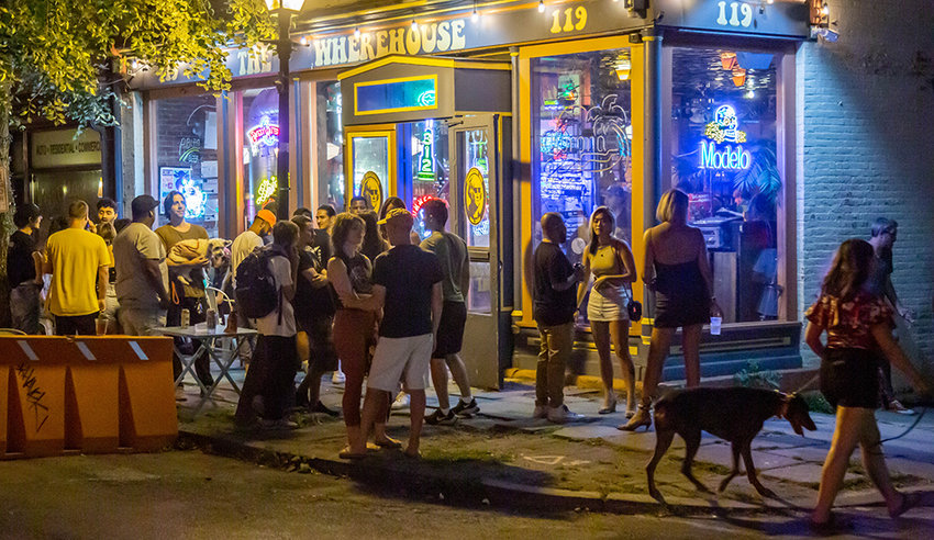 Patrons and well-wishers gathered outside The Wherehouse on Liberty Street, Friday at an event organized as a show of support for the establishment that was recently vandalized.