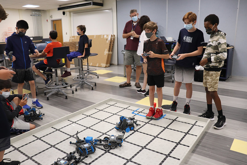 A group of Highland Middle School students test out their robotic creations.