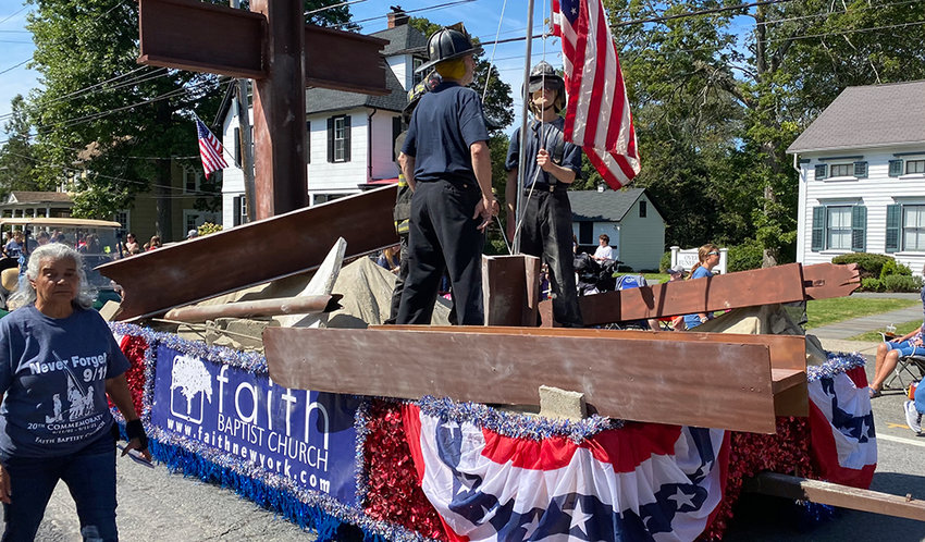 """The Faith Baptist Church float recreated the famous """"Raising the Flag at Ground Zero"""" photograph in honor of the 20th anniversary of the September 11th attacks."""
