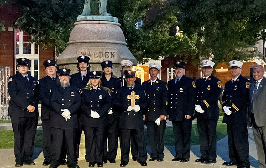 Members of the Walden Fire Department pose with Walden Mayor John Ramos at the village's Sept. 11 ceremony on Saturday. Members of the department assisted in the aftermath of the attacks.
