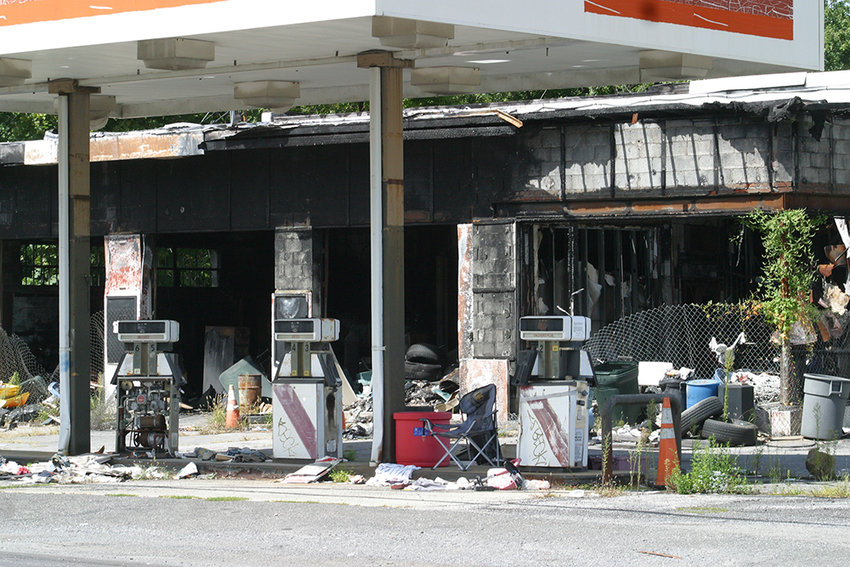 The former Dennis' Sunoco at the city's western border, was destroyed in a 2018 fire.