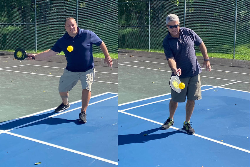 Recreation Coordinator Mike Bliss (l) and Walden Mayor John Ramos (l.) exchange a volley at Bradley Park's new pickleball court.