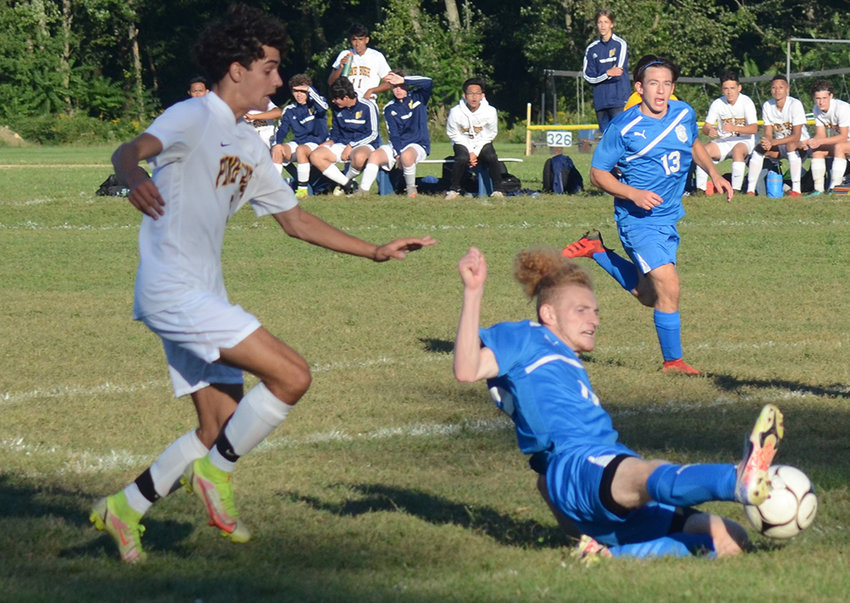 Valley Central's Dominic Ciano slides after the ball as Pine Bush's Joseph Darrell pursues and Valley Central's Kyle Cocks looks on during Friday's OCIAA boys' soccer game at Valley Central High School in Montgomery.