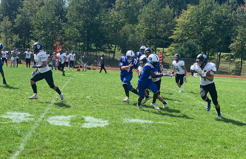 Ty Crowley of Wallkill returning a punt vs. Monticello Saturday.