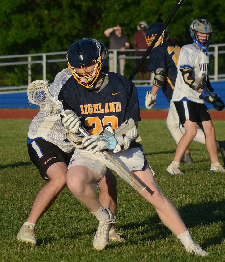 Highland's Dean Klotz tries to maneuver around the defense of Valley Central's Carter Laughman during a boys' lacrosse game at Valley Central High School in Montgomery on June.