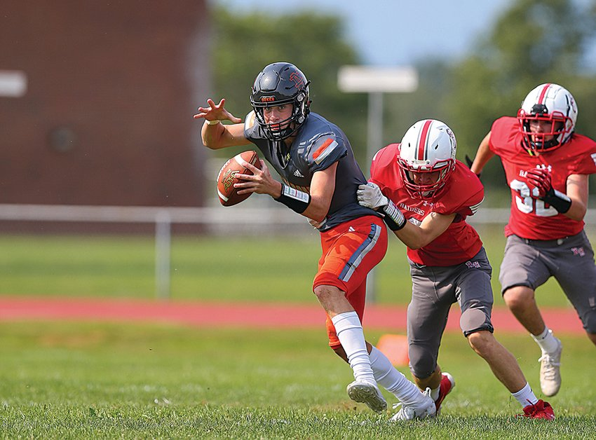 Collin Casey tries to escape from Red Hook's Luca Soave during second quarter action.