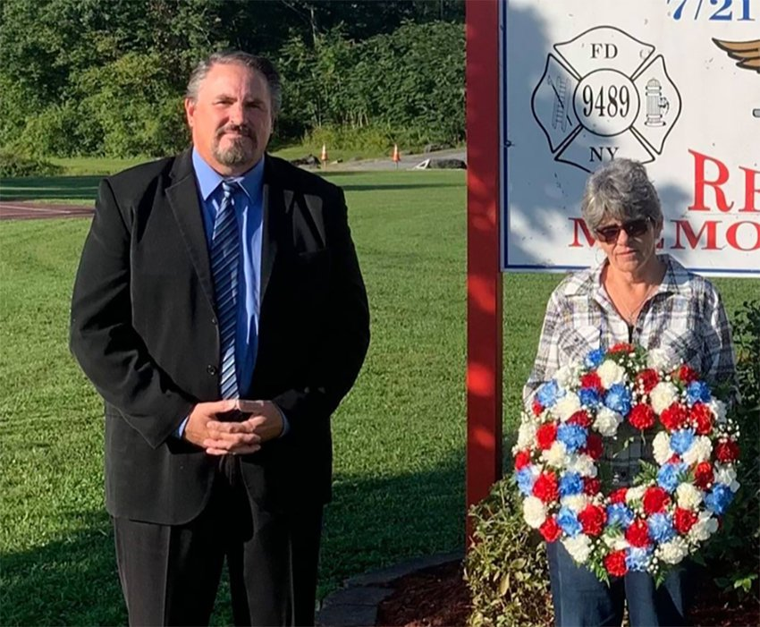 Maybrook Mayor Dennis Leahy poses with Kathy Emhardt, fiancé of Maybrook resident and New York City Fireman David Weiss. Emhardt holds a wreath to memorialize her late fiancé.