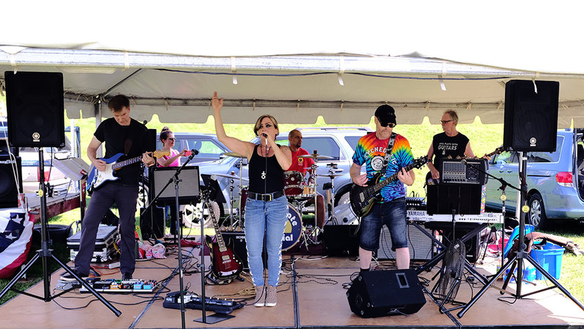 The Blue Plate Special Band performed a variety of pop and rock'n roll music all afternoon. Genesse Rochetti handled the vocal chores while Julian Baker played keyboards, Bill Kenny on bass, Justin Brown on drums and John Ferro on lead guitar.
