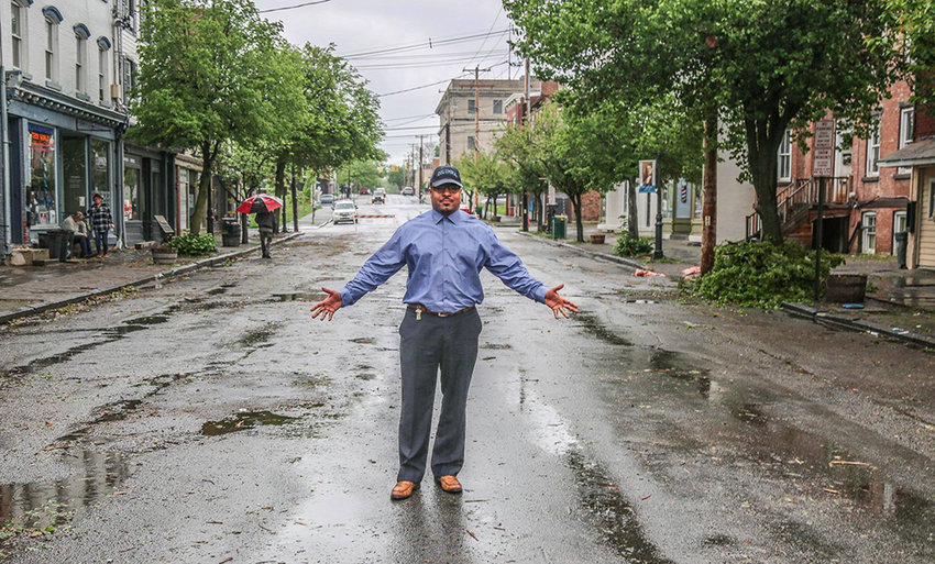 Mayor Torrance Harvey, shown in 2018 after a tornado ripped through the Liberty Street business district, is glad to see once-empty buildings occupied.
