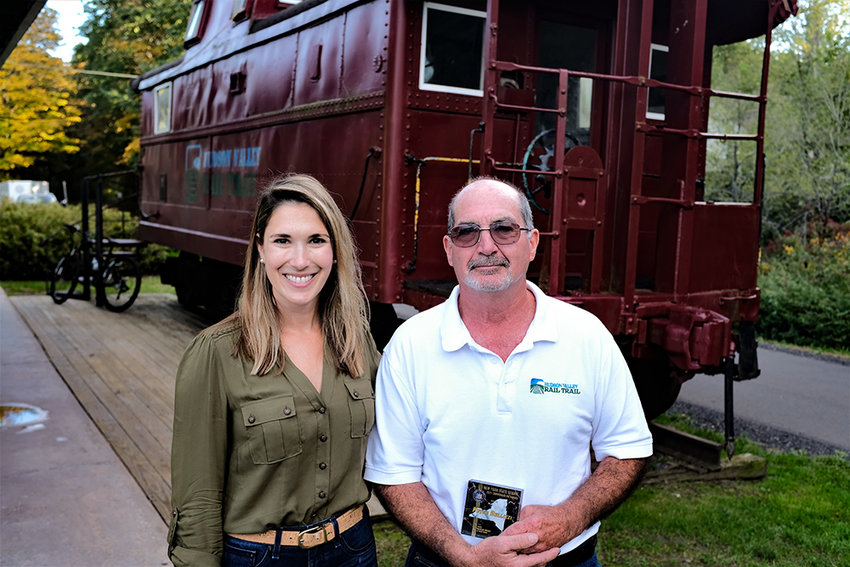 Sen. Michelle Hinchey [D-46] and Hudson Valley Rail Trail Association President Peter Bellizzi stand beside a caboose at the trail-head. Hinchey presented Bellizzi with a NYS Commendation for his commitment and selfless service to the Rail Trail.