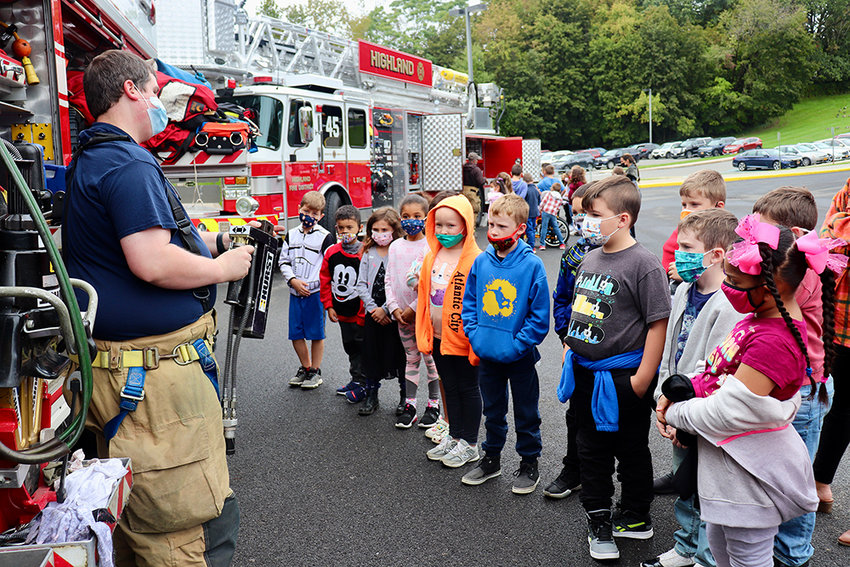 Highland Elementary School students receive a guided tour from a local fire department, learning about the equipment, its function and were able to ask the firefighters questions.
