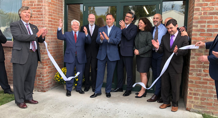 The cutting of the white ribbon celebrates the grand opening and 50th anniversary of Catania, Mahon & Rider, PLLC.