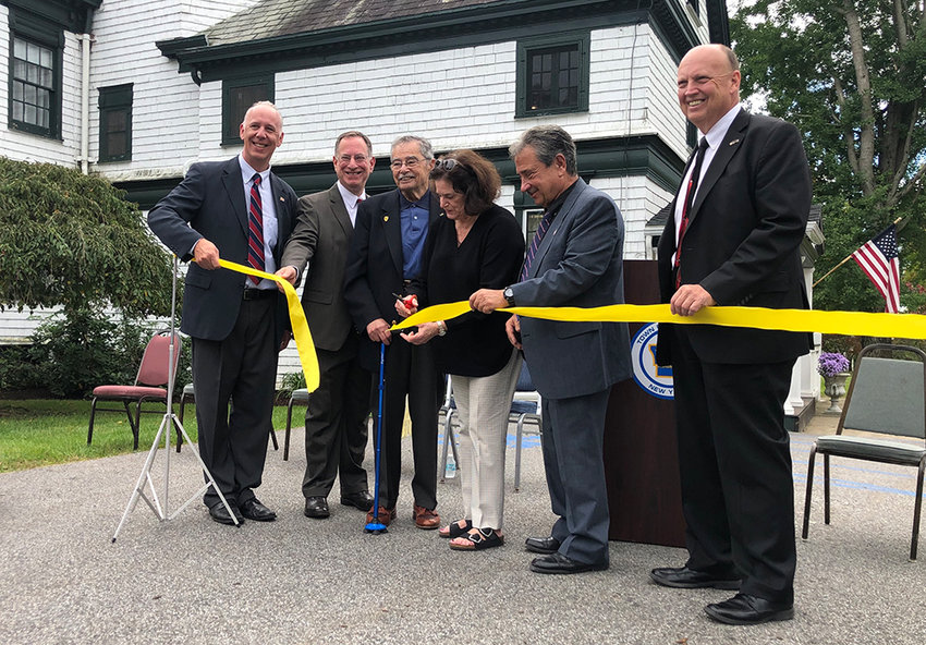 L – r: Councilman Anthony LoBiondo, Orange County Legislator Mike Anagnostakis, William Kaplan with his daughter Joan, Town Supervisor Gilbert Piaquadio and Councilman Scott Manley join together for the ribbon cutting.