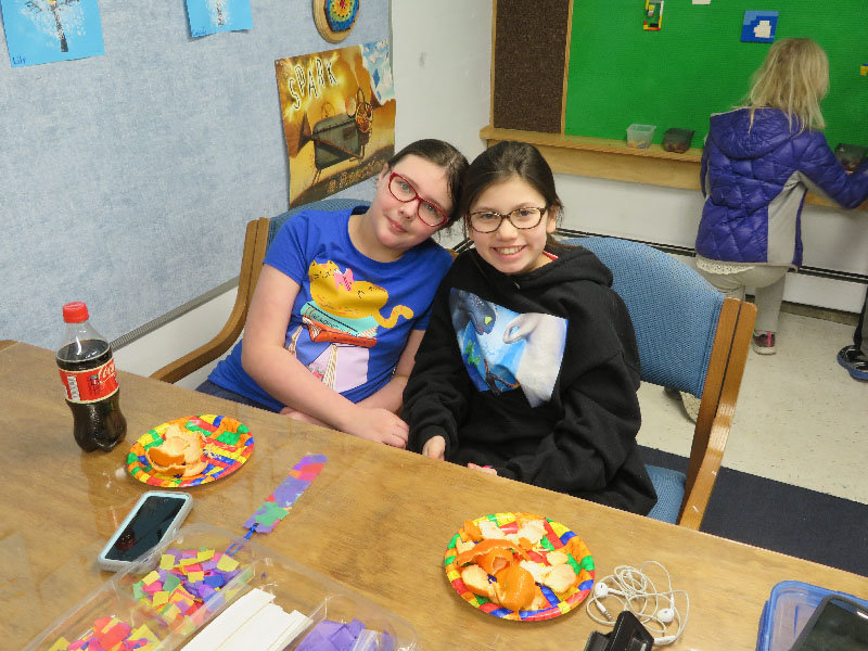 Keira (left) and Julia attend the Wallkill Library for National Take Your Child to the Library Day.