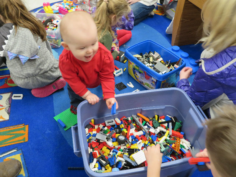 Aubri plays with Legos during Wallkill Library's National Take Your Child to the Library Day.