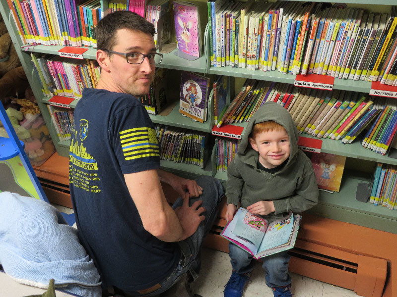 Braden (left) and Jackson look for books at Wallkill Library's National Take Your Child to the Library Day.