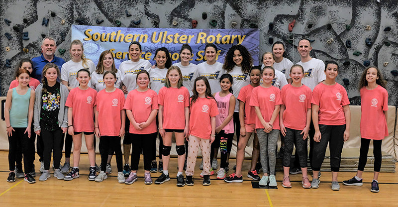 The New Paltz Hawks paid another visit to offer pointers to younger girls learning to play volleyball in Plattekill. Front row L-R Naavah Schmidt (partially hidden), Aubriana Barbosa, Rory Cafarella, Caitlyn Murphy, Sydney Lowery,  Olivia Martino, Ava O'Flaherty, Lillian Kirpatrick, Melia Martinez, Jaelynn Florentino, Talia Greek, Abby Martino, Bianca Ramos and Bryanna Wallace. Back row L-R Coach Will Farrell, Kerri Neville, Caleigh Carr, Demi Herasme, Olivia D'Antonio, Emily Visintini, Julie Greenspan, Amber Elson, Nicole Fellone, Haley Timarky and Hawks Coach Matt Giufre.