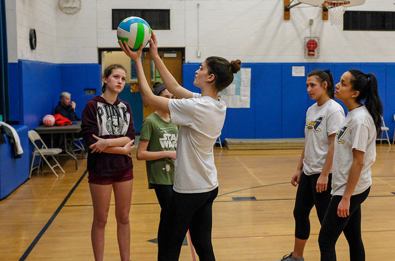 SUNY Hawk Emily Visintini shows the younger players just how to set up a serve.