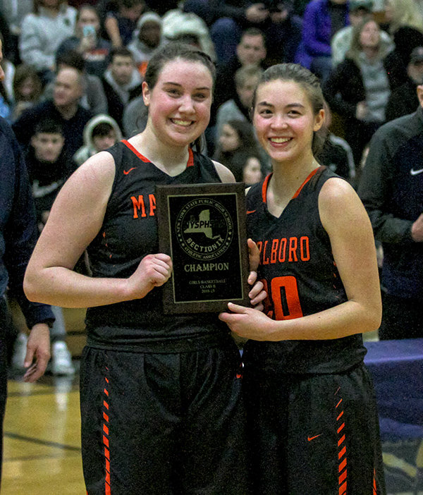 Captains Erin Lofaro, left, and Jetta Stephens, right, pose with the newest addition to Marlboro's trophy case after the Lady Duke's won the Section 9 championship last weekend.
