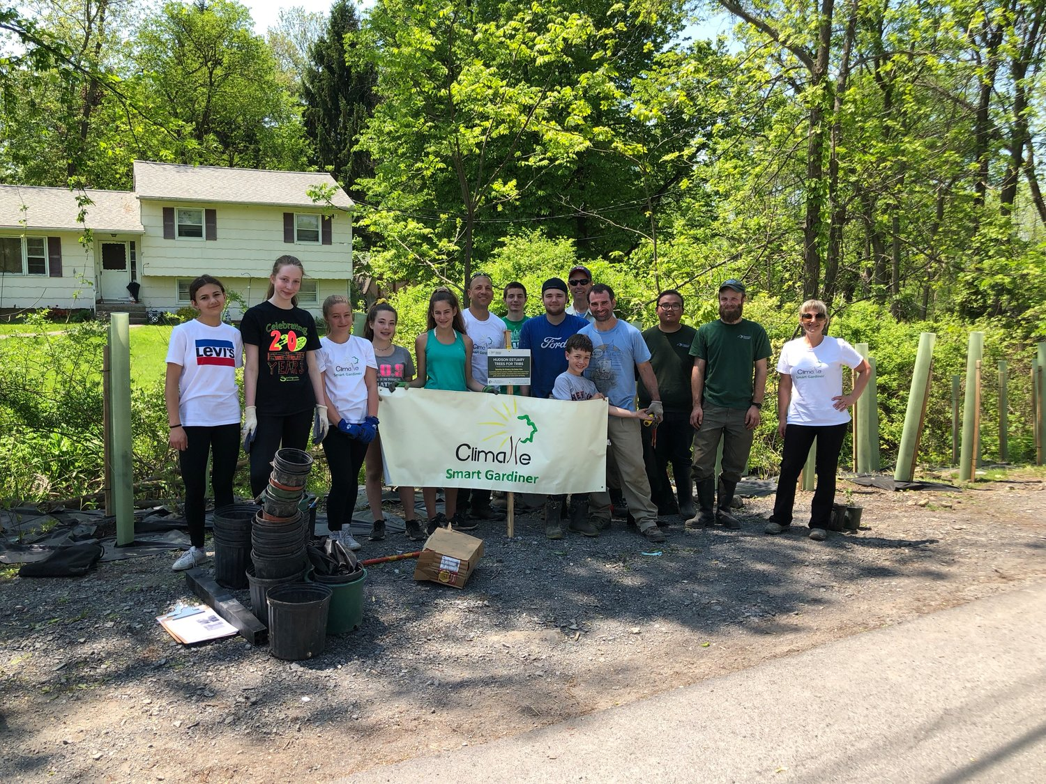 Climate Smart Gardiner members plant trees along the Wallkill River in a trees for tribs event.