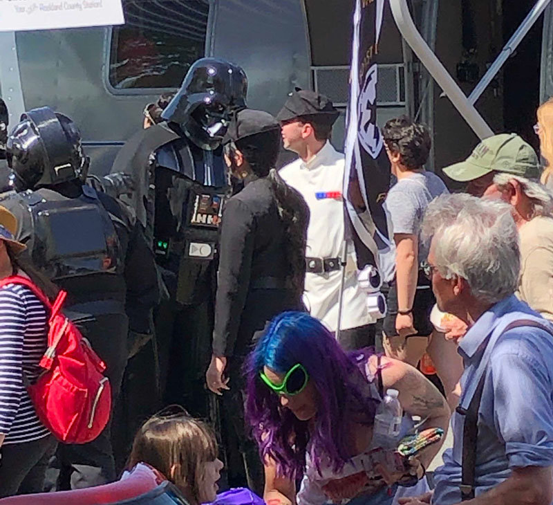 Darth Vader entertains a gathering.