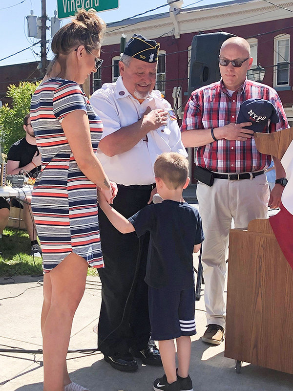 Fire Commissioner Fraino, Paul Hansut and grandson Lorenzo escorted by Mom to recite Pledge of Allegiance.
