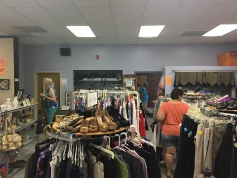 Patrons browse the racks at the One More Time Thrift Shop in Highland.