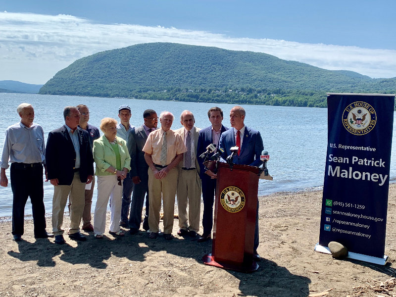 Rep Sean Patrick maloney, (right) speaking at a press conference last week to discuss a resolution to ban oil barge anchorages on the Hudson River.