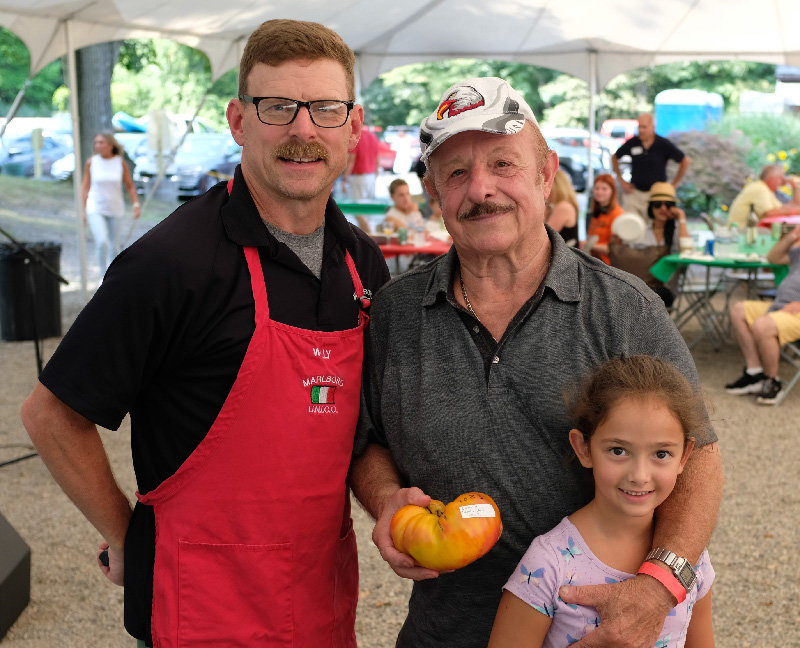 Lenny Scaturro won 1st Place in the senior category and was the Grand Prize winner with his 1,023 gram tomato. Scaturro's  granddaughter Juliana and Willy Biggin pose with him.