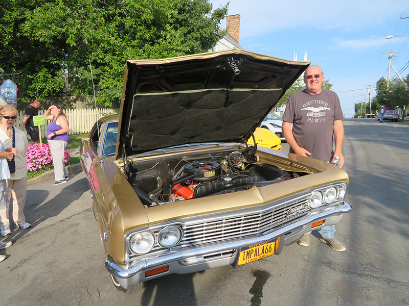 George Charles shows his 1966 Impala.