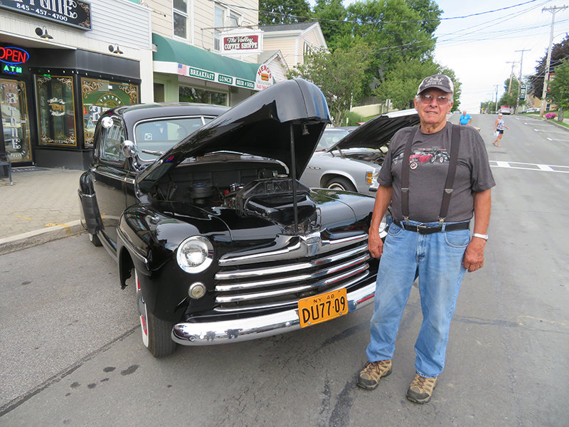 Clark Cortright shows his 1948 Ford Coupe.