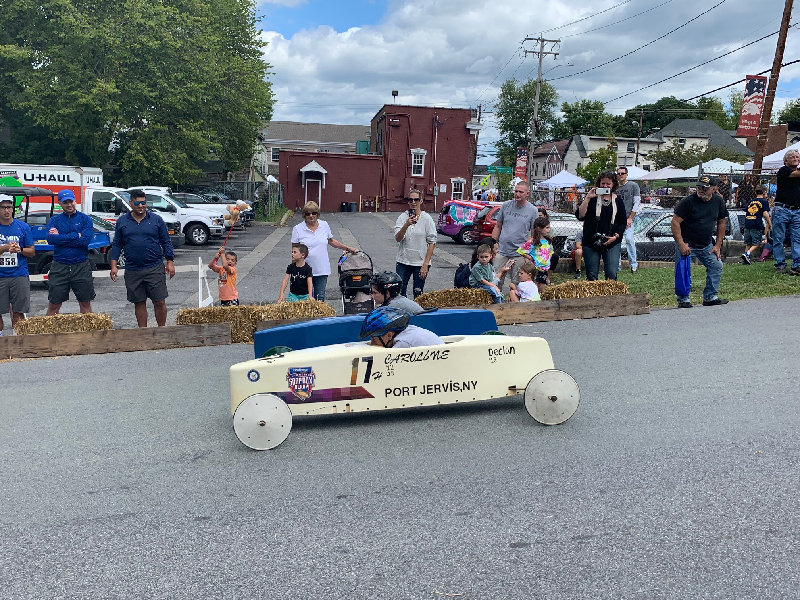 Cub scouts race against each other in the soap box derby.