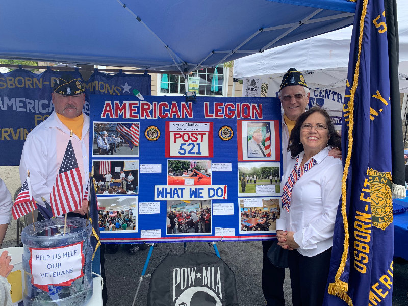 (From left) America Legion member John Moore, Vice Commander Grady Schenck and Auxiliary President Marion Schenck man the booth for the American Legion Post 521.