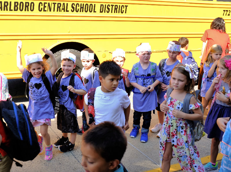 Kids' faces reflect a joyous first day of school.